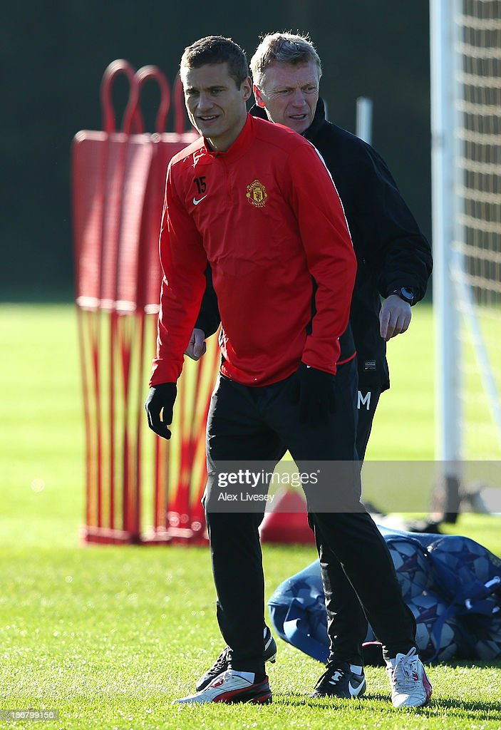 <a gi-track='captionPersonalityLinkClicked' href=/galleries/search?phrase=Nemanja+Vidic&family=editorial&specificpeople=497253 ng-click='$event.stopPropagation()'>Nemanja Vidic</a> of Manchester United looks on during a training session at Aon Training Complex on November 4, 2013 in Manchester, England.
