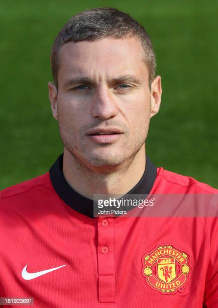 Nemanja Vidic of Manchester United poses at the annual club photocall at Old Trafford on September 26 2013 in Manchester England