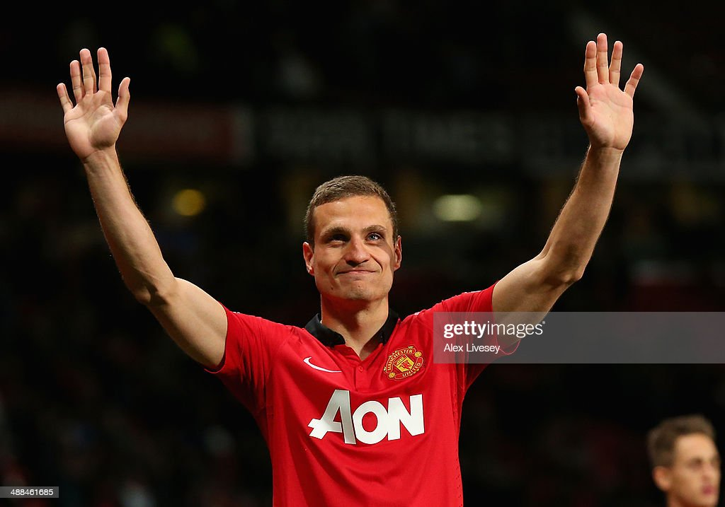 <a gi-track='captionPersonalityLinkClicked' href=/galleries/search?phrase=Nemanja+Vidic&family=editorial&specificpeople=497253 ng-click='$event.stopPropagation()'>Nemanja Vidic</a> of Manchester United salutes the fans after his final home game for the club at the end of the Barclays Premier League match between Manchester United and Hull City at Old Trafford on May 6, 2014 in Manchester, England.