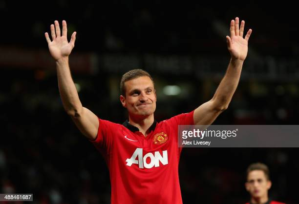 Nemanja Vidic of Manchester United salutes the fans after his final home game for the club at the end of the Barclays Premier League match between...