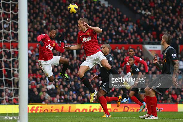 Nemanja Vidic of Manchester United scores the second goal from a deflected Patrice Evra header during the Barclays Premier League match between...
