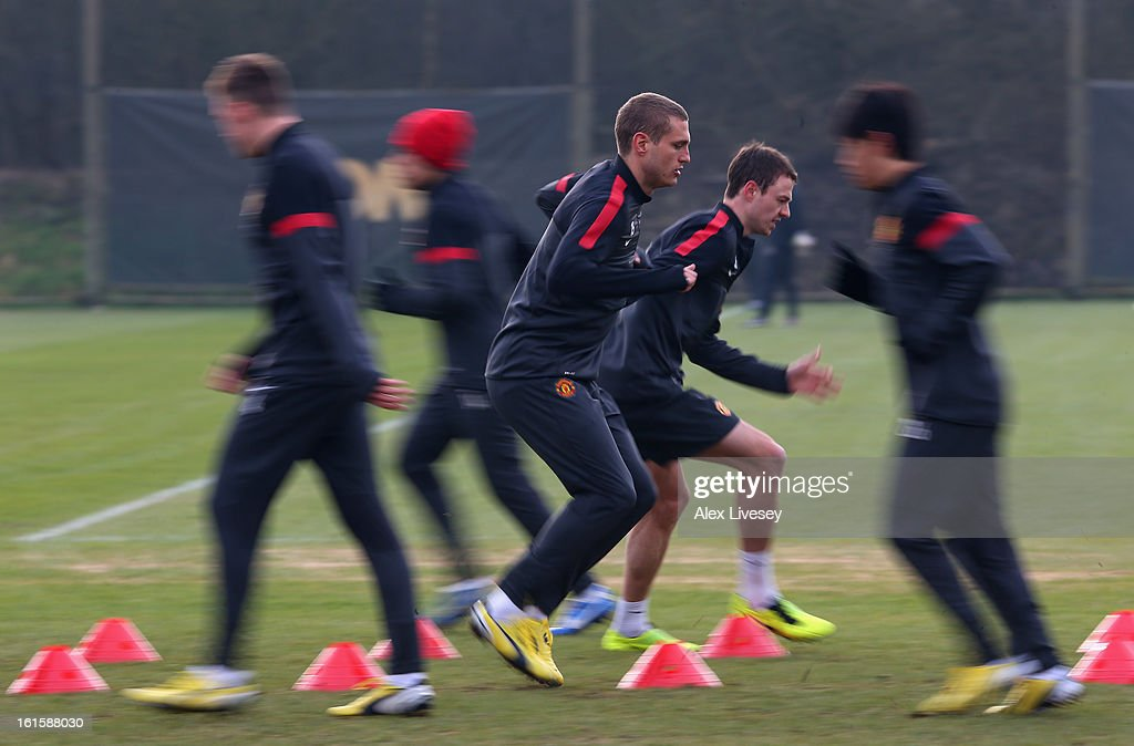 <a gi-track='captionPersonalityLinkClicked' href=/galleries/search?phrase=Nemanja+Vidic&family=editorial&specificpeople=497253 ng-click='$event.stopPropagation()'>Nemanja Vidic</a> of Manchester United warms up during a training session at the Carrington Training Ground on February 12, 2013 in Manchester, England.