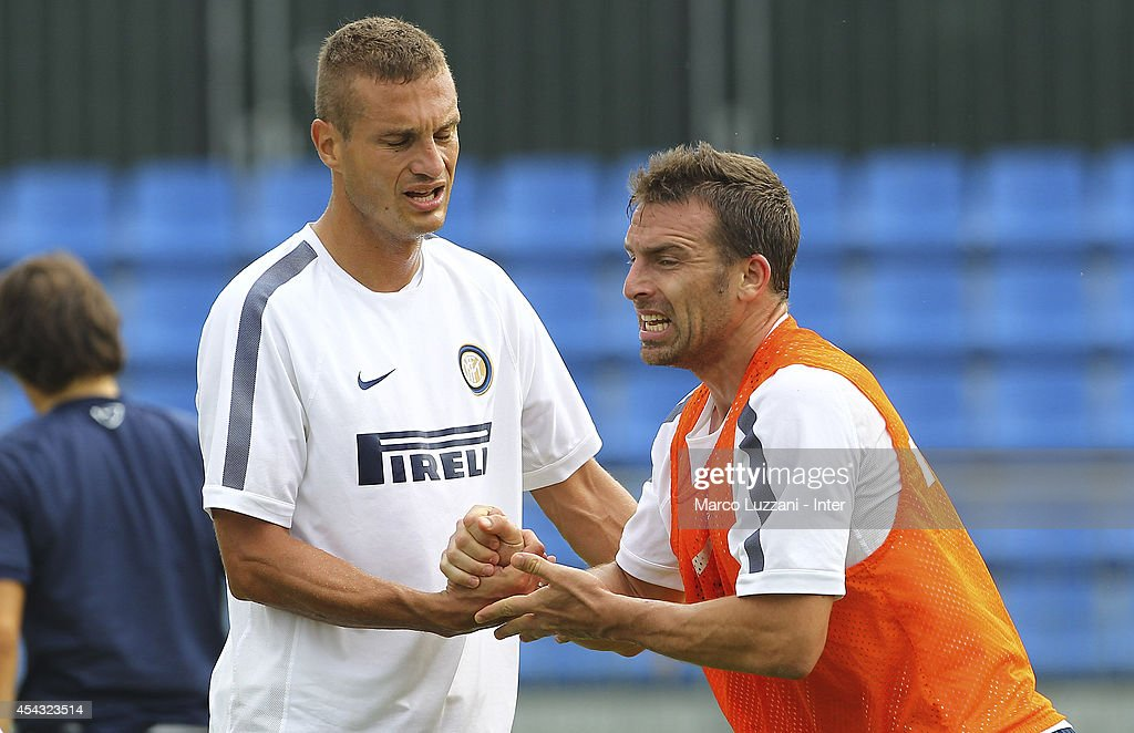 <a gi-track='captionPersonalityLinkClicked' href=/galleries/search?phrase=Nemanja+Vidic&family=editorial&specificpeople=497253 ng-click='$event.stopPropagation()'>Nemanja Vidic</a> shakes hands with Hugo Armando Campagnaro of FC Internazionale Milano looks on during FC Internazionale Training Session at the club's training ground on August 29, 2014 in Appiano Gentile Como, Italy.