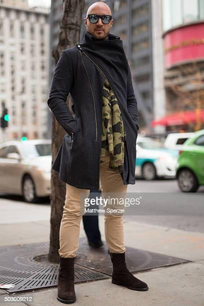 Nemanja Vucicevic is seen on Michigan Avenue wearing Ray Ban glasses dark grey Tornado Mart coat camo green HM scarf and black Vince boots on...
