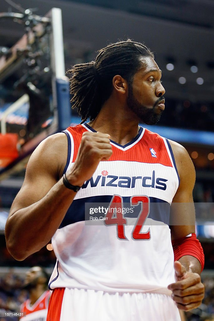 Nenê #42 of the Washington Wizards celebrates after scoring a second half basket during the Wizards 84-82 win over the Portland Trail Blazers at Verizon Center on November 28, 2012 in Washington, DC.