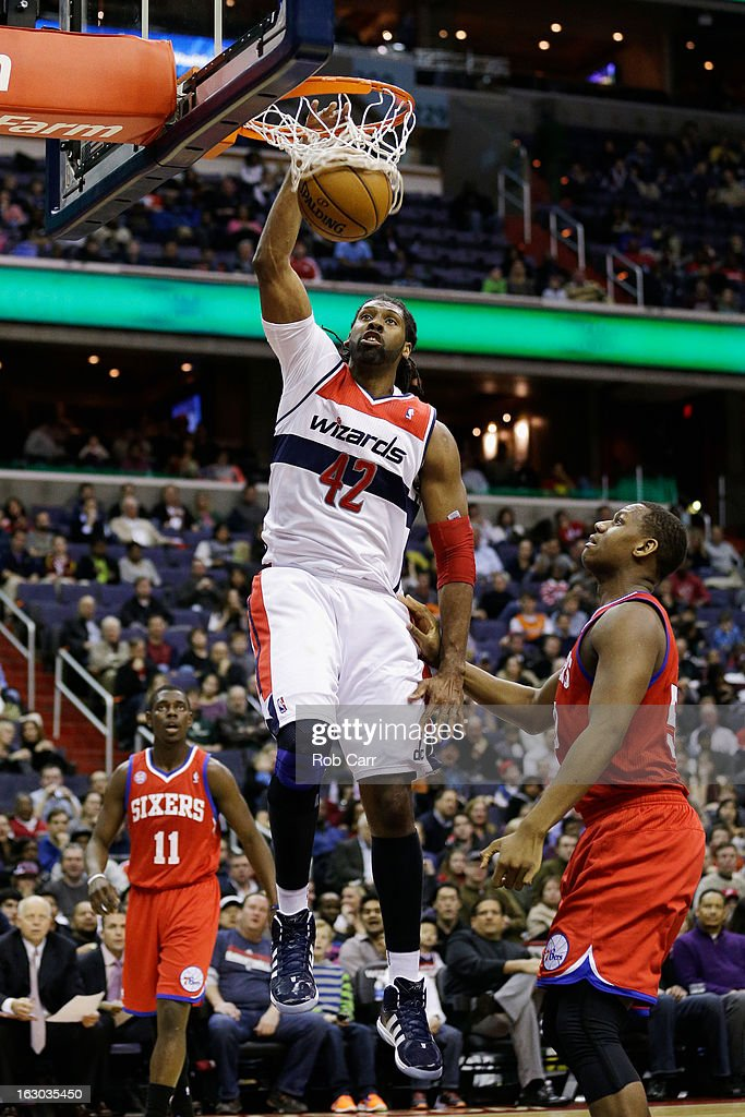 Nenê #42 of the Washington Wizards dunks in front of Lavoy Allen #50 and Jrue Holiday #11 of the Philadelphia 76ers during the first half at Verizon Center on March 3, 2013 in Washington, DC.