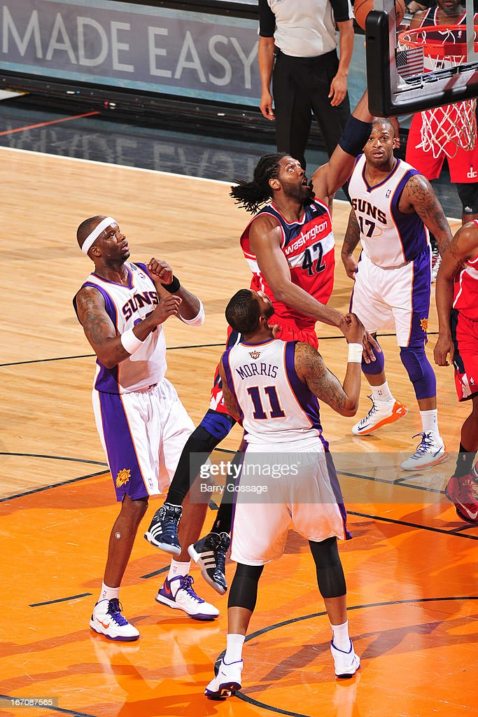 Nenê #42 of the Washington Wizards goes strong to the hoop against the Phoenix Suns on March 20, 2013 at U.S. Airways Center in Phoenix, Arizona.