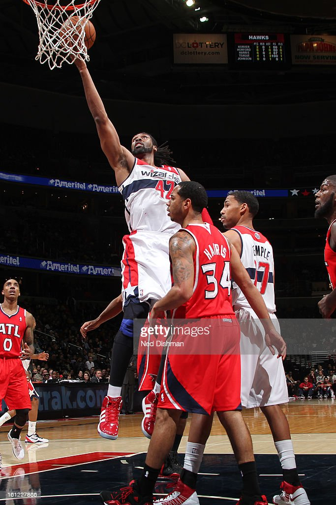 Nenê #42 of the Washington Wizards goes up strong to the basket against the Atlanta Hawks during the game at the Verizon Center on January 12, 2013 in Washington, DC.