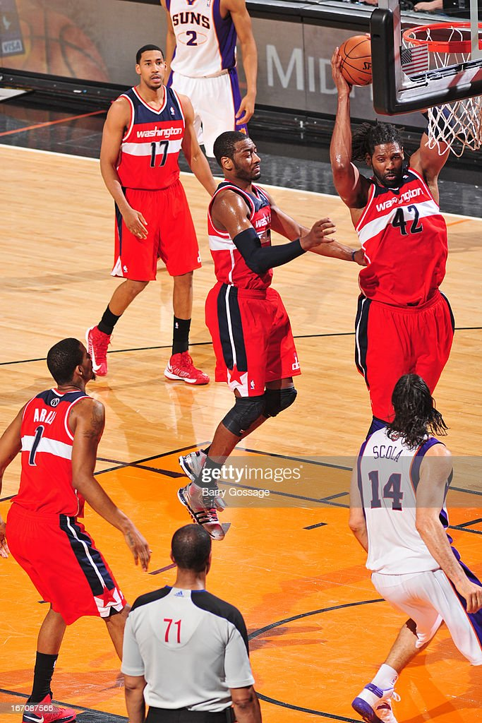 Nenê #42 of the Washington Wizards grabs the rebound against the Phoenix Suns on March 20, 2013 at U.S. Airways Center in Phoenix, Arizona.