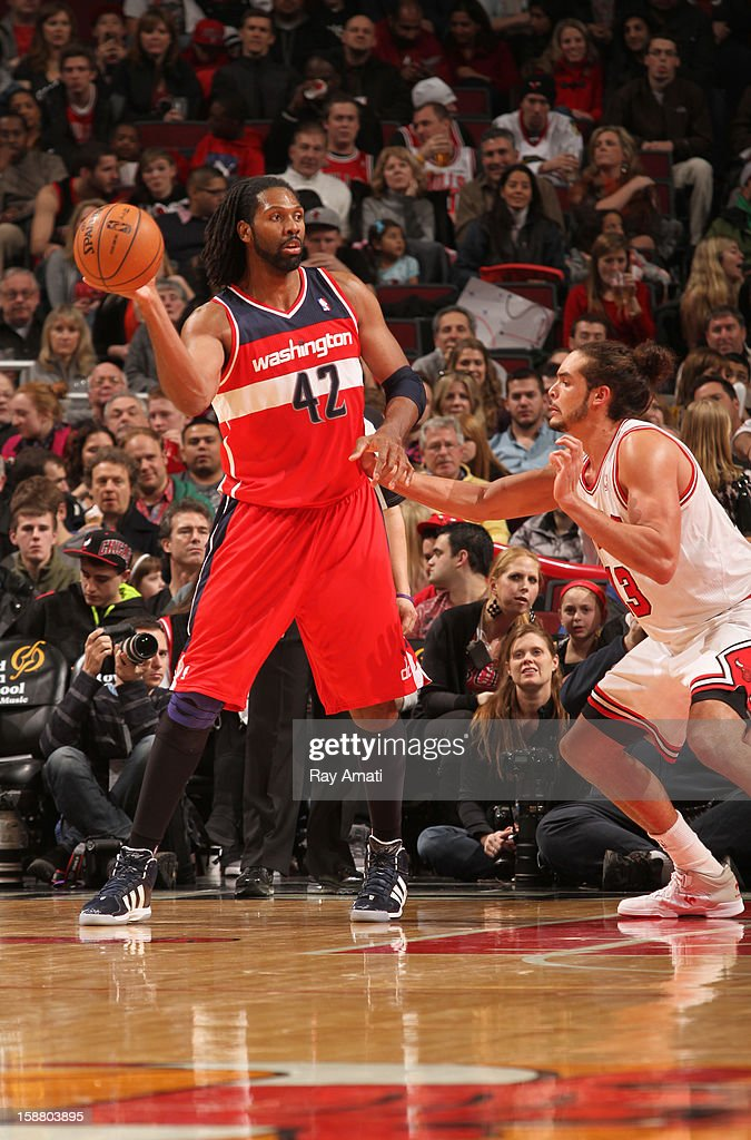 Nené #42 of the Washington Wizards looks to pass the ball against <a gi-track='captionPersonalityLinkClicked' href=/galleries/search?phrase=Joakim+Noah&family=editorial&specificpeople=699038 ng-click='$event.stopPropagation()'>Joakim Noah</a> #13 of the Chicago Bulls on December 29, 2012 at the United Center in Chicago, Illinois.