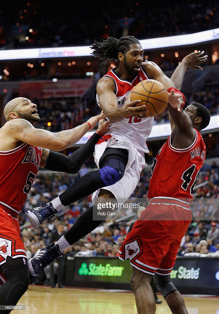 Nenê #42 of the Washington Wizards puts up a shot between the defense of <a gi-track='captionPersonalityLinkClicked' href=/galleries/search?phrase=Carlos+Boozer&family=editorial&specificpeople=201638 ng-click='$event.stopPropagation()'>Carlos Boozer</a> #5 and <a gi-track='captionPersonalityLinkClicked' href=/galleries/search?phrase=Nazr+Mohammed&family=editorial&specificpeople=201690 ng-click='$event.stopPropagation()'>Nazr Mohammed</a> #48 of the Chicago Bulls during the second half at Verizon Center on April 2, 2013 in Washington, DC.