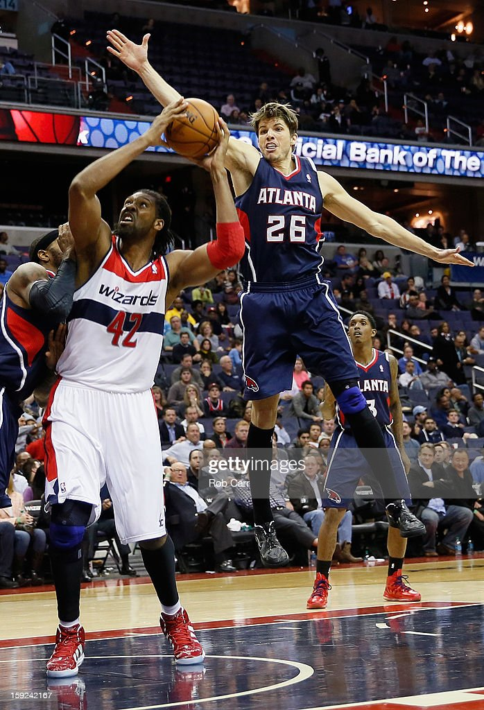 Nenê #42 of the Washington Wizards puts up a shot in front of <a gi-track='captionPersonalityLinkClicked' href=/galleries/search?phrase=Kyle+Korver&family=editorial&specificpeople=202504 ng-click='$event.stopPropagation()'>Kyle Korver</a> #26 of the Atlanta Hawks at Verizon Center on December 18, 2012 in Washington, DC.