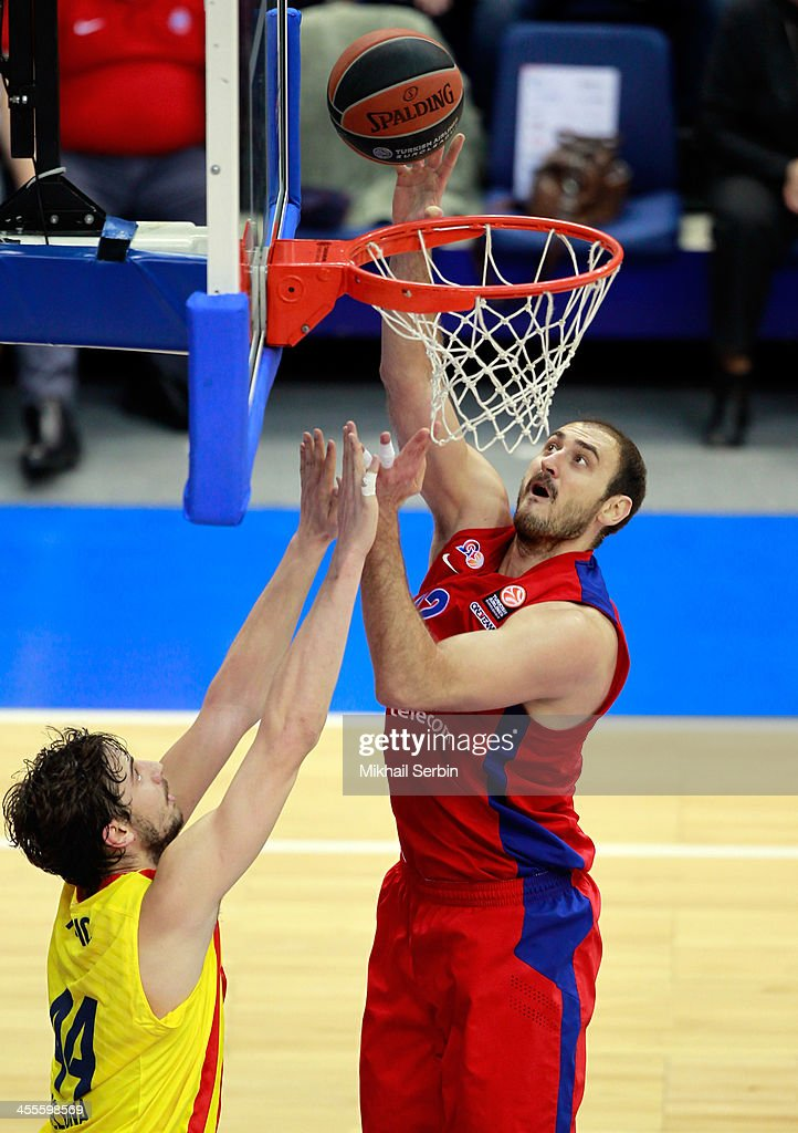 Nenad Krstic, #12 of CSKA Moscow competes with Ante Tomic, #44 of FC Barcelona in action during the 2013-2014 Turkish Airlines Euroleague Regular Season Date 9 game between CSKA Moscow v FC Barcelona at USH CSKA on December 12, 2013 in Moscow, Russia.