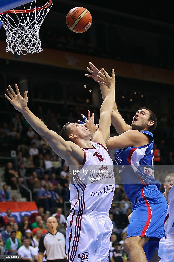 <a gi-track='captionPersonalityLinkClicked' href=/galleries/search?phrase=Nenad+Krstic&family=editorial&specificpeople=202625 ng-click='$event.stopPropagation()'>Nenad Krstic</a> of Serbia (R) shoots over Andrejs Selakovs of Latvia during the EuroBasket 2011 first round group B match between Latvia and Serbia at Siauliai Arena on September 1, 2011 in Siauliai, Lithuania.