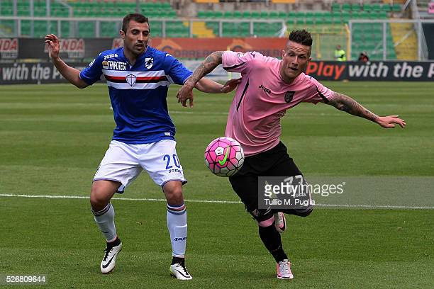 Nenad Krsticic of Sampdoria and Michel Morganella of Palermo compete for the ball during the Serie A match between US Citta di Palermo and UC...
