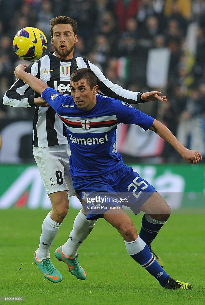 Nenad Krsticic (R) of UC Sampdoria in action against Claudio Marchisio of Juventus FC during the Serie A match between Juventus FC and UC Sampdoria at Juventus Arena on January 6, 2013 in Turin, Italy.