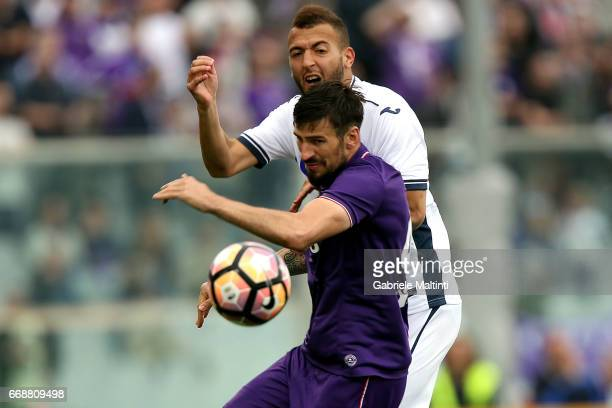 Nenad Tomovic of ACF Fiorentina battles for the ball with Omar El Kaddouri of Empoli FC during the Serie A match between ACF Fiorentina and Empoli FC...