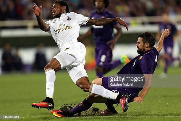 Nenad Tomovic of ACF Fiorentina fights for the ball with Luiz Adriano of AC Milan during the Serie A match between ACF Fiorentina and AC Milan at...