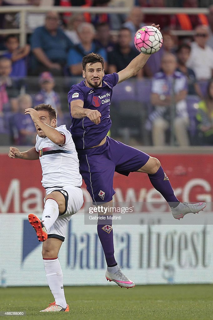 Nenad Tomovic of ACF Fiorentina in action against <a gi-track='captionPersonalityLinkClicked' href=/galleries/search?phrase=Diego+Capel&family=editorial&specificpeople=4164836 ng-click='$event.stopPropagation()'>Diego Capel</a> of Genoa CFC during the Serie A match between ACF Fiorentina and Genoa CFC at Stadio Artemio Franchi on September 12, 2015 in Florence, Italy.