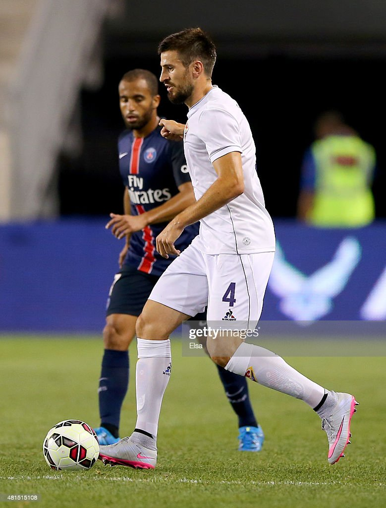 Nenad Tomovic #4 of AFC Fiorentina takes the ball as Lucas Moura #7 of Paris Saint-Germain defends during the International Champions Cup at Red Bull Arena on July 21, 2015 in Harrison, New Jersey.Paris Saint-Germain defeated ACF Fiorentina 4-2.