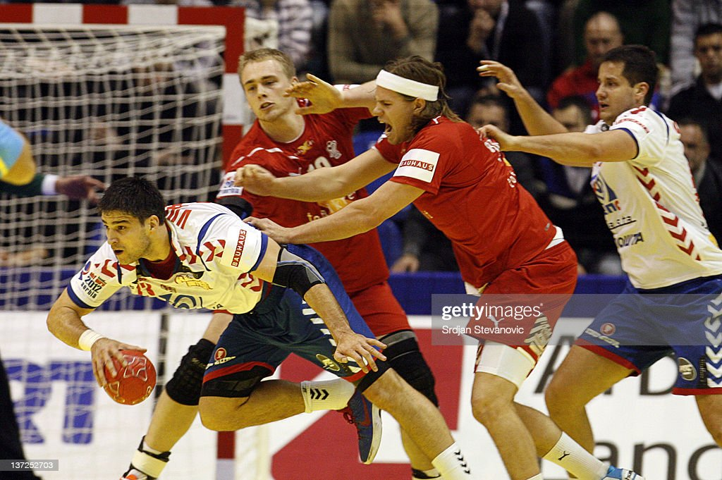 Nenad Vockovic of Serbia (L) is fouled by Mikkel Hansen (R) of Denmark during the Men's European Handball Championship 2012 group A match between Serbia and Denmark at Pionir Arena on January 17, 2011 in Belgrade, Serbia.