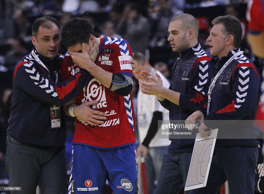 Nenad Vuckovic (R) looks dejected after Serbia lost the match during the Men's European Handball Championship 2012 final match between Serbia and Denmark at Arena Hall on January 29, 2012 in Belgrade, Serbia.