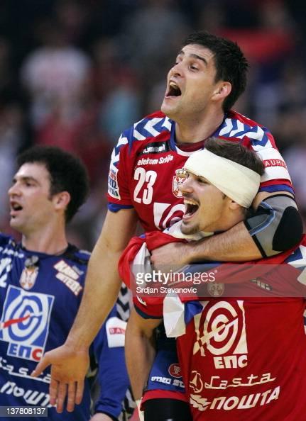 Nenad Vuckovic Nikola Manojlovic and Darko Stanic celebrate victory against Croatia during the Men's European Handball Championship 2012 semifinal...