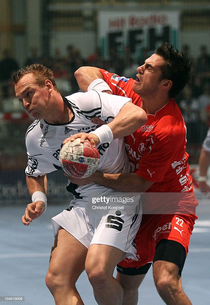 Nenad Vuckovic of Melsungen (R) attacks <a gi-track='captionPersonalityLinkClicked' href=/galleries/search?phrase=Christian+Zeitz&family=editorial&specificpeople=620399 ng-click='$event.stopPropagation()'>Christian Zeitz</a> of Kiel (L) during the Toyota Handball Bundesliga match between MT Melsungen and THW Kiel at the Rotehnbach Hall on September 28, 2010 in Kassel, Germany.