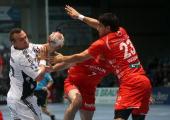 Nenad Vuckovic of Melsungen challenges Christian Zeitz of Kiel during the Toyota Handball Bundesliga match between MT Melsungen and THW Kiel at the...