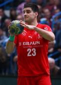 Nenad Vuckovic of Melsungen controles the ball during the Toyota Handball Bundesliga match between T VGrosswallstadt and MT Melsungen at fan...