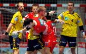 Nenad Vuckovic of Melsungen is challenged by Bjarte Myrhol of RheinNeckar Loewen during the Toyota Handball Bundesliga match between MT Melsungen and...