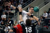 Nenad Vuckovic of Melsungen is challenged by Bjarte Myrhol of RheinNeckar Loewen during the Toyota Handball Bundesliga match between RheinNeckar...