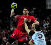 Nenad Vuckovic of Melsungen is challenged by Igor Anic of Kiel during the Toyota Handball Bundesliga match between THW Kiel and MT Melsungen at the...