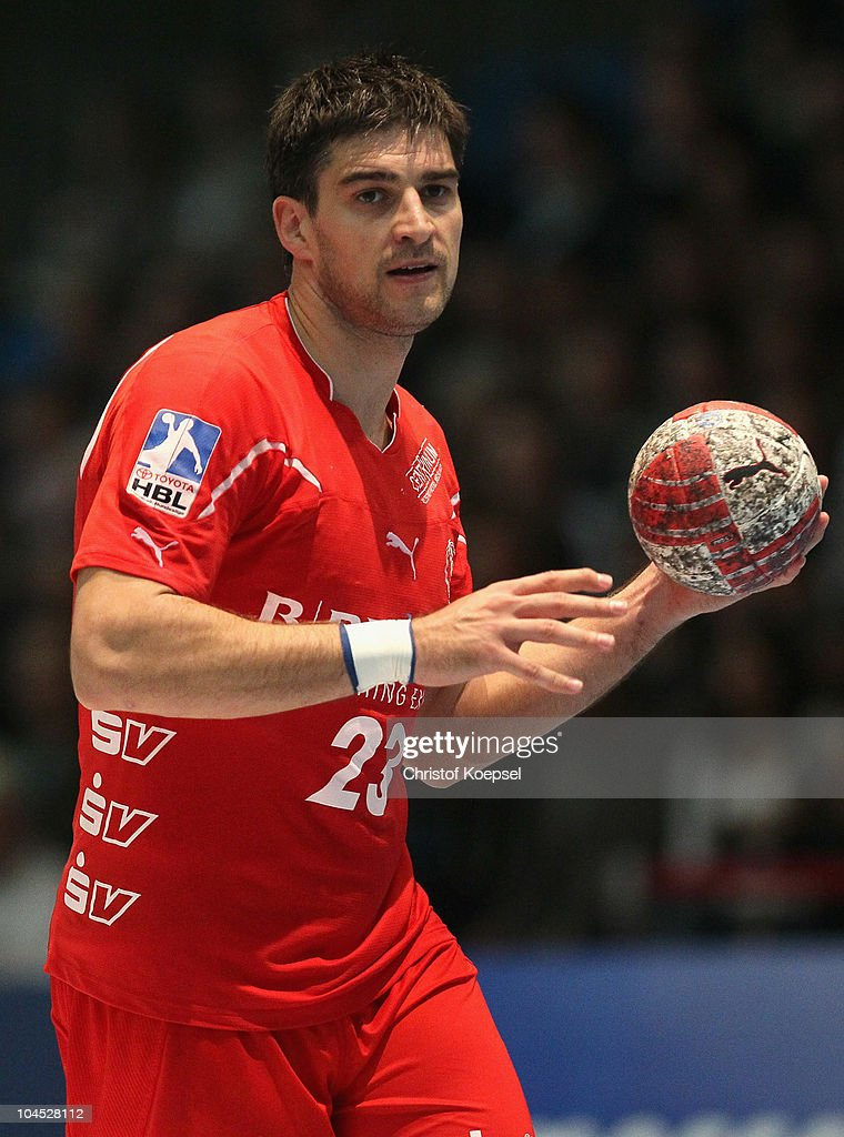 Nenad Vuckovic of Melsungen passes the ball during the Toyota Handball Bundesliga match between MT Melsungen and THW Kiel at the Rotehnbach Hall on September 28, 2010 in Kassel, Germany.