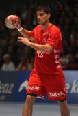 Nenad Vuckovic of Melsungen passes the ball during the Toyota Handball Bundesliga match between MT Melsungen and THW Kiel at the Rotehnbach Hall on...