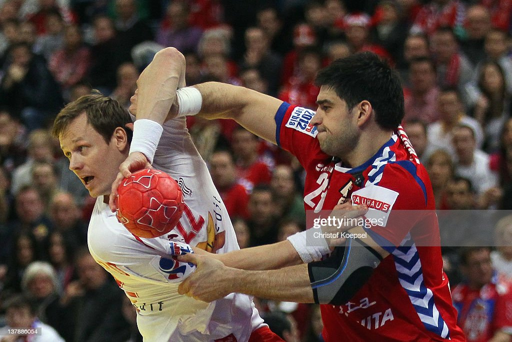 Nenad Vuckovic of Serbia (R) defends against Kasper Soendergaard Sarup of Denmark (L) during the Men's European Handball Championship final match between Serbia and Denmark at Beogradska Arena on January 29, 2012 in Belgrade, Serbia.