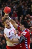 Nenad Vuckovic of Serbia defends against Kasper Soendergaard Sarup of Denmark during the Men's European Handball Championship final match between...