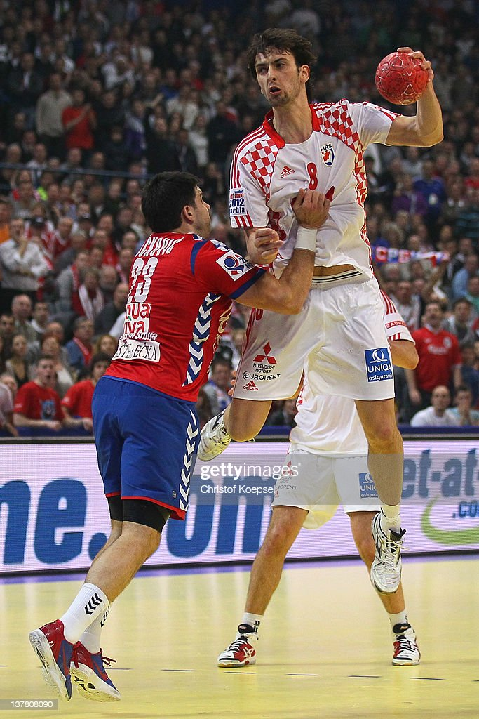 Nenad Vuckovic of Serbia defends against Marko Kopljar of Croatia during the Men's European Handball Championship second semi final match between Serbia and Croatia at Beogradska Arena on January 27, 2012 in Belgrade, Serbia.