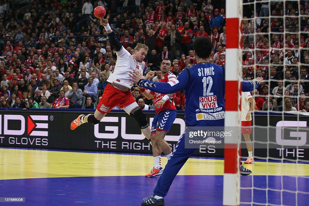 Nenad Vuckovic of Serbia (C) defends against Rene Toft Hansen of Denmark (L) during the Men's European Handball Championship final match between Serbia and Denmark at Beogradska Arena on January 29, 2012 in Belgrade, Serbia.