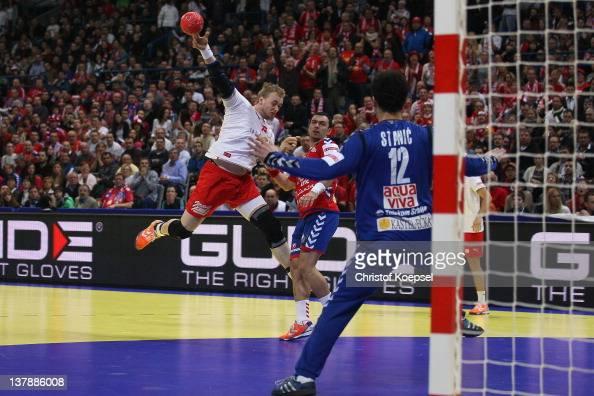 Nenad Vuckovic of Serbia defends against Rene Toft Hansen of Denmark during the Men's European Handball Championship final match between Serbia and...