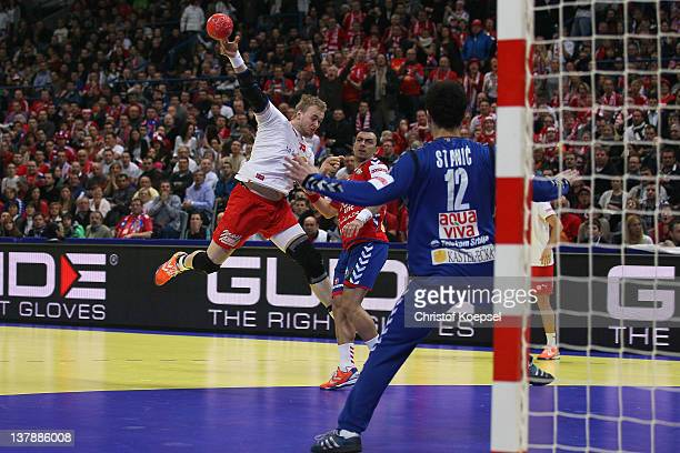 Nenad Vuckovic of Serbia defends against Rene Toft Hansen of Denmark during the Men's European Handball Championship final match between Serbia and...