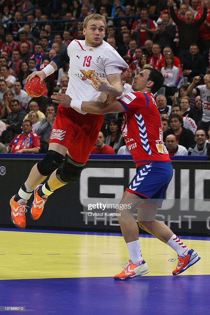 Nenad Vuckovic of Serbia (R) defends against Rene Toft Hansen of Denmark (L) during the Men's European Handball Championship final match between Serbia and Denmark at Beogradska Arena on January 29, 2012 in Belgrade, Serbia.