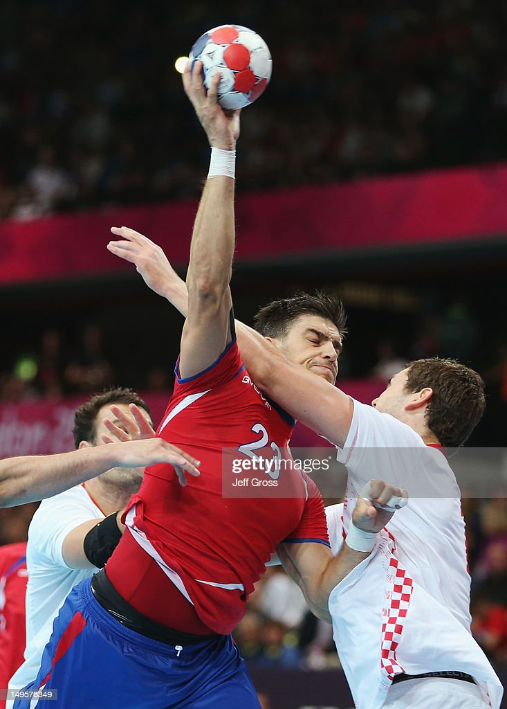 Nenad Vuckovic of Serbia (23) shoots and scores during the Men's Handball Preliminary match between Serbia and Croatia on Day 4 of the London 2012 Olympic Games at The Copper Box on July 31, 2012 in London, England.