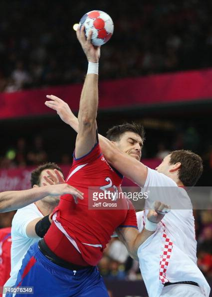 Nenad Vuckovic of Serbia shoots and scores during the Men's Handball Preliminary match between Serbia and Croatia on Day 4 of the London 2012 Olympic...