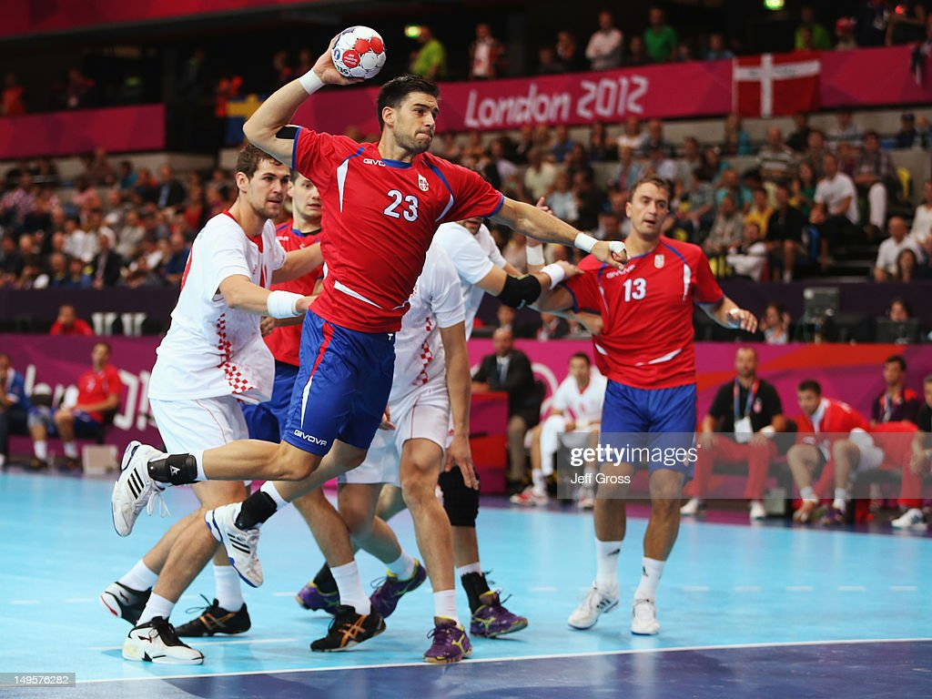 Nenad Vuckovic of Serbia (23) shoots during the Men's Handball Preliminary match between Serbia and Croatia on Day 4 of the London 2012 Olympic Games at The Copper Box on July 31, 2012 in London, England.