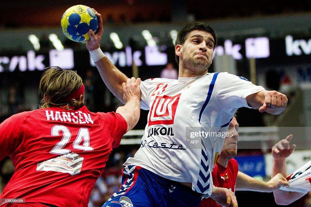 Nenad Vuckovic (R) of Serbia shoots over Mikkel Hansen (L) of Denmark during the Men's Handball World Championship Group C match Denmark vs Serbia in Malmo, Sweden on January 17, 2011.