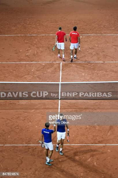 Nenad Zimonjic and Filip Krajinovic of Serbia and Pierre Hugues Herbert and Nicolas Mahut of France during the day 2 of the Semifinals of the Davis...