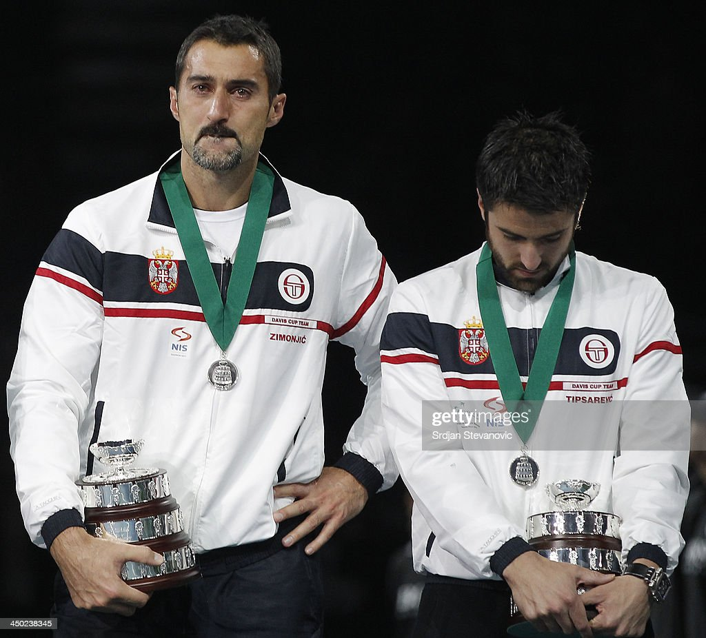 Nenad Zimonjic (L) and Janko Tipsarevic looks dejected after Serbia lost the final during the award ceremony of the Davis Cup World Group Final between Serbia and Czech Republic at Kombank Arena on November 17, 2013 in Belgrade, Serbia.