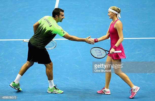 Nenad Zimonjic and Kristina Mladenovic of the UAE Royals celebrate a point against Seren Williams and Tomas Berdych of the Singapore Slammers during...