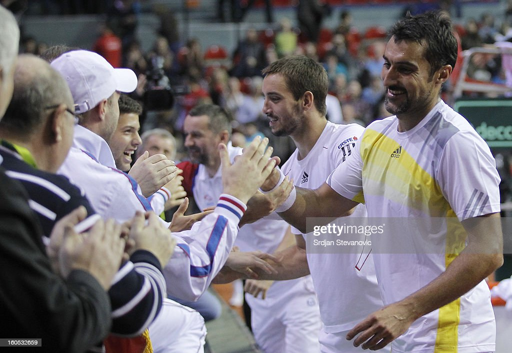 Nenad Zimonjic (R) and Viktor Troicki (L) of Serbia celebrate victory against Belgium after the Davis Cup doubles first round match between Belgium and Serbia, at Spirou dome February 02, 2013 in Charleroi, Belgium.